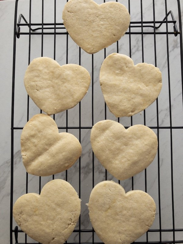 Heart shaped cookies on cooling rack