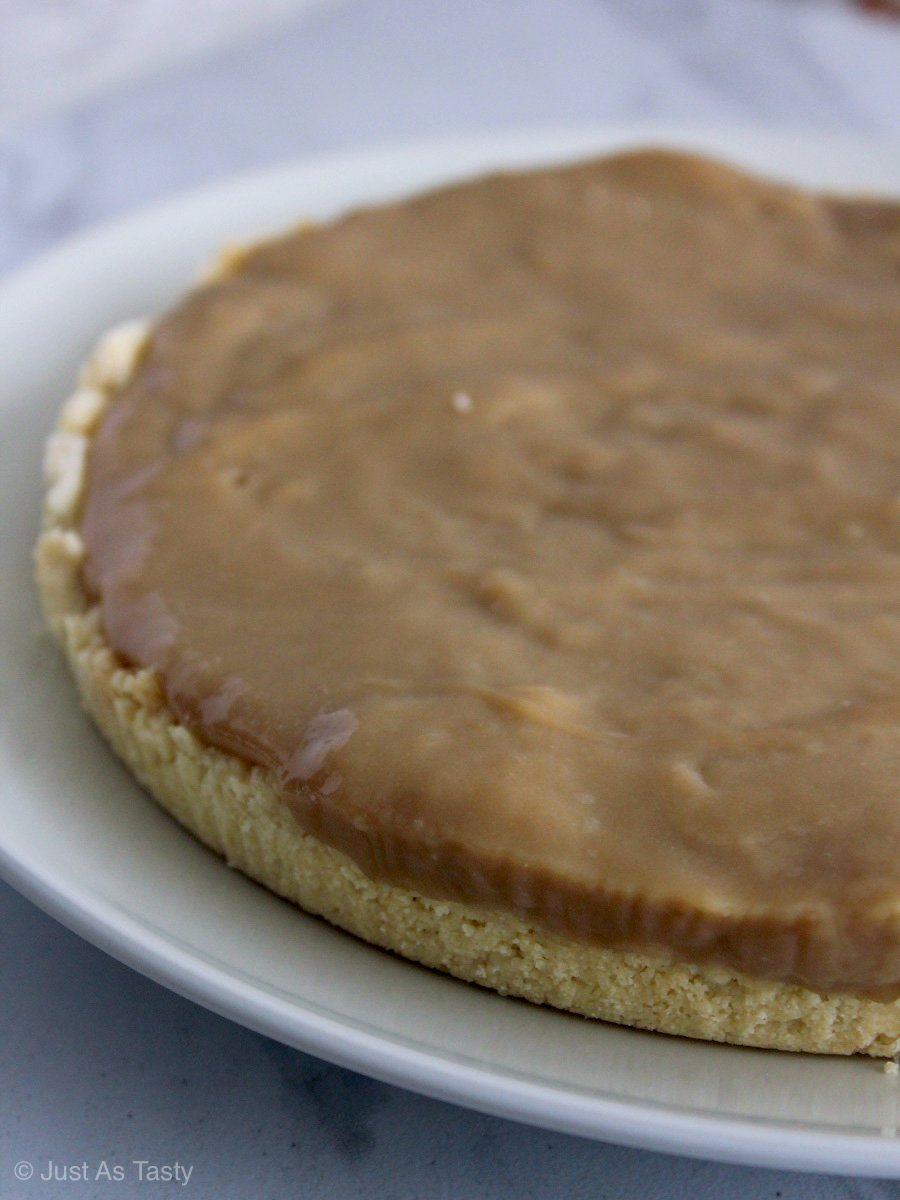 Eggless butterscotch pie on a white plate.