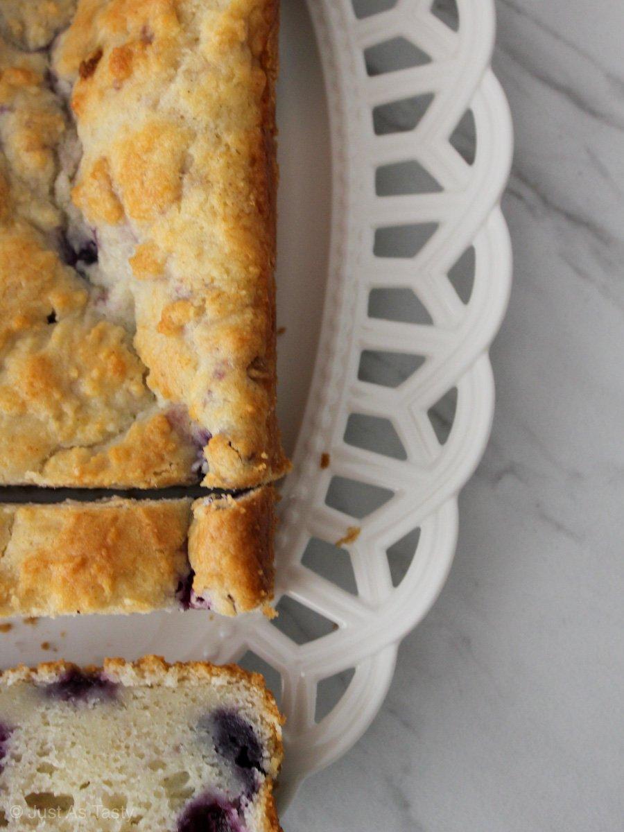 Lemon blueberry loaf on a white platter