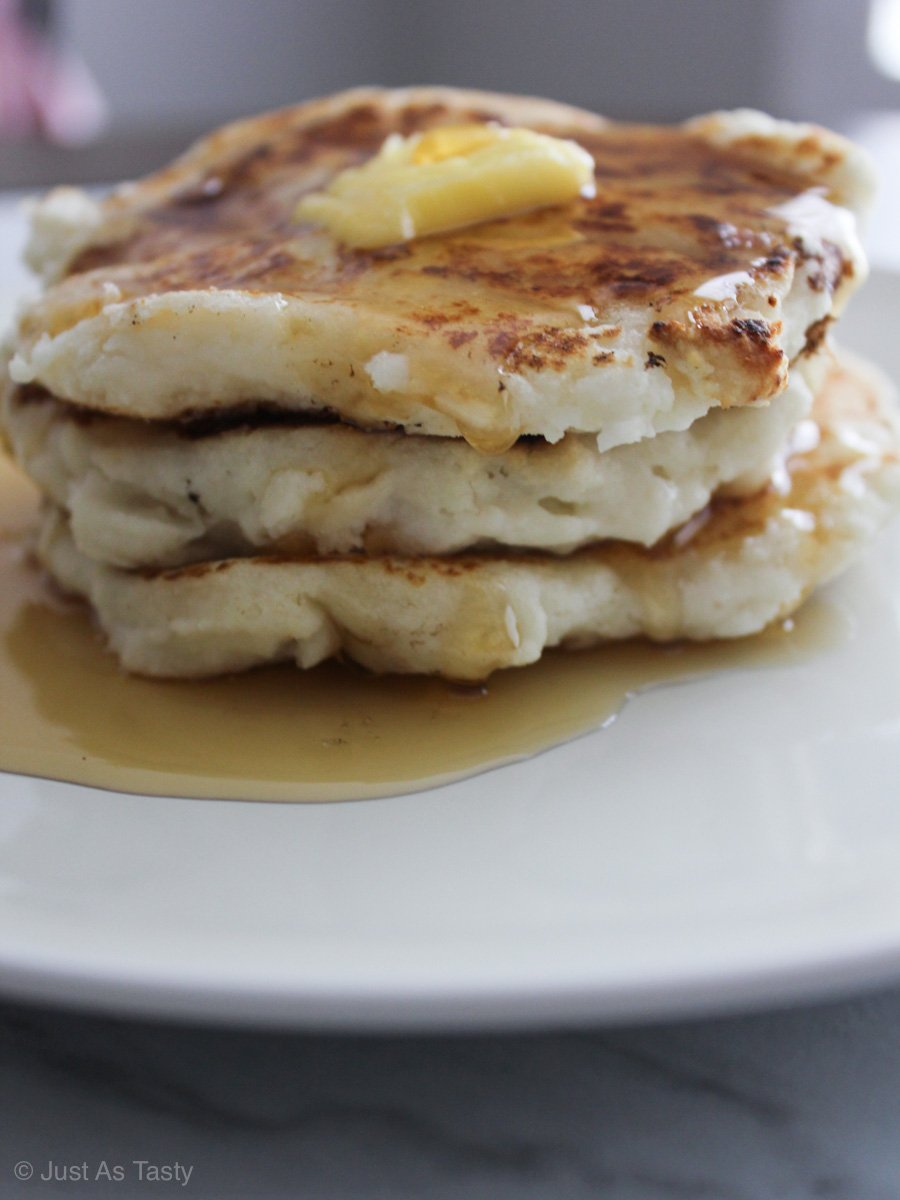 Stack of pancakes with butter and syrup.