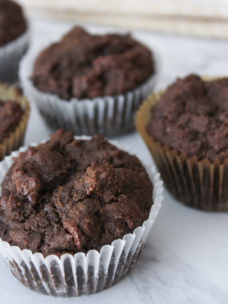 Gluten free chocolate muffins on a marble surface.