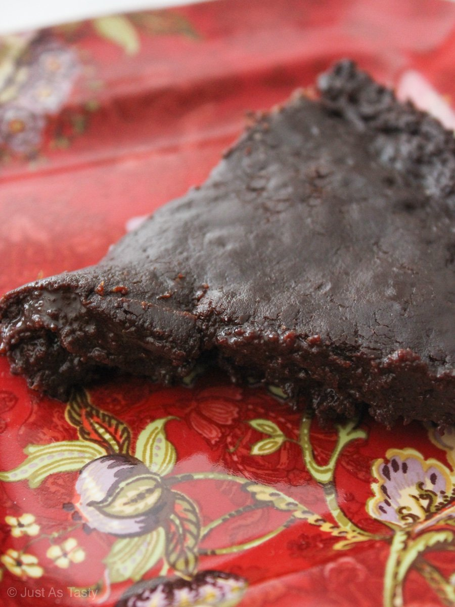 Close-up of chocolate cake slice on red plate