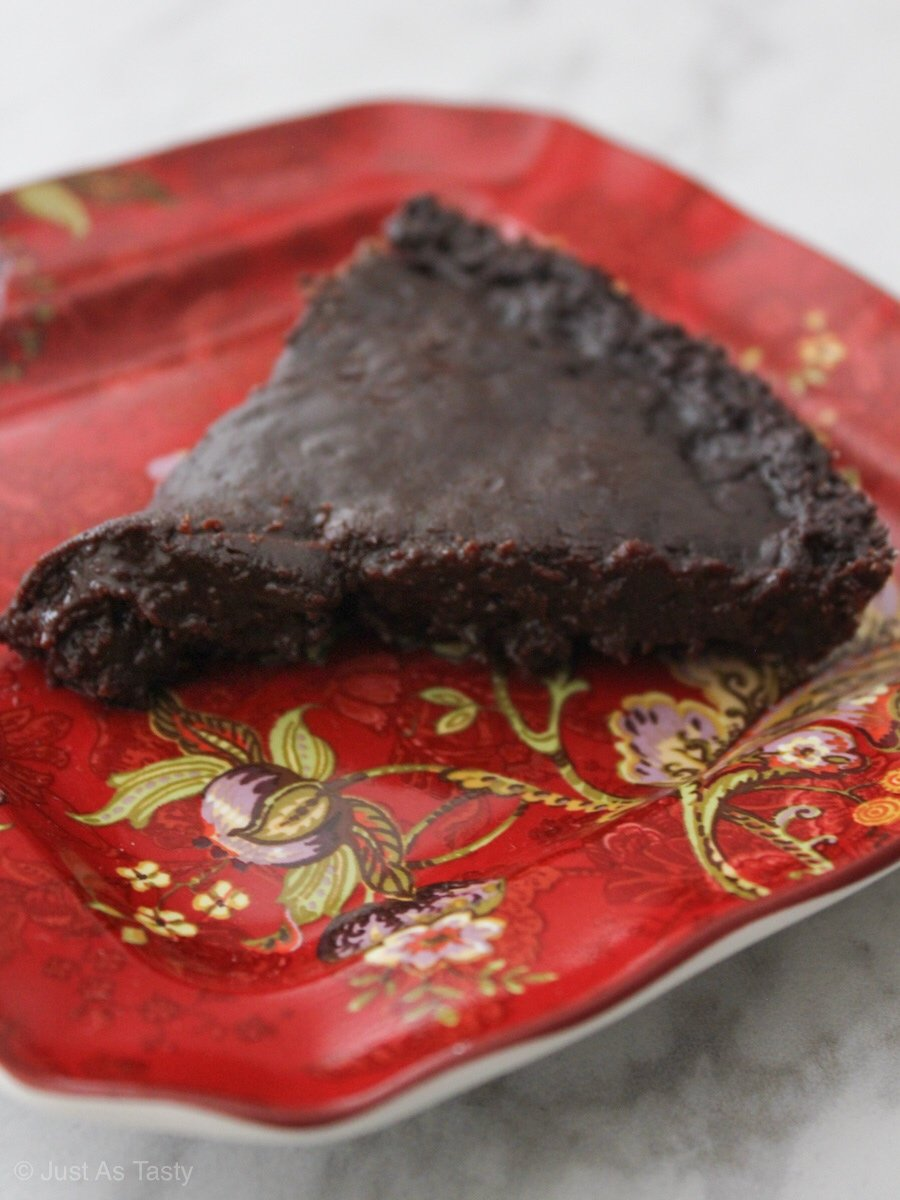 Slice of chocolate cake on a red plate