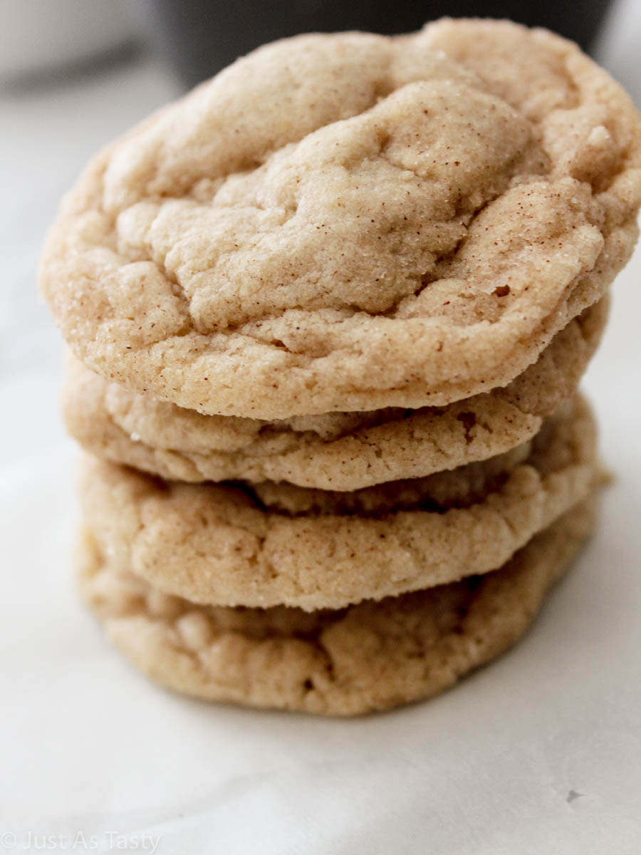 Stack of gluten free snickerdoodles on a white surface.