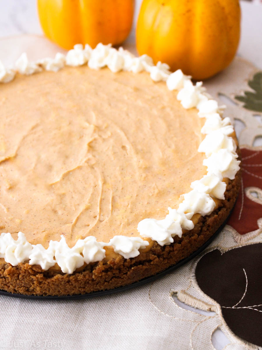 Gluten free pumpkin cheesecake with whipped cream topping.