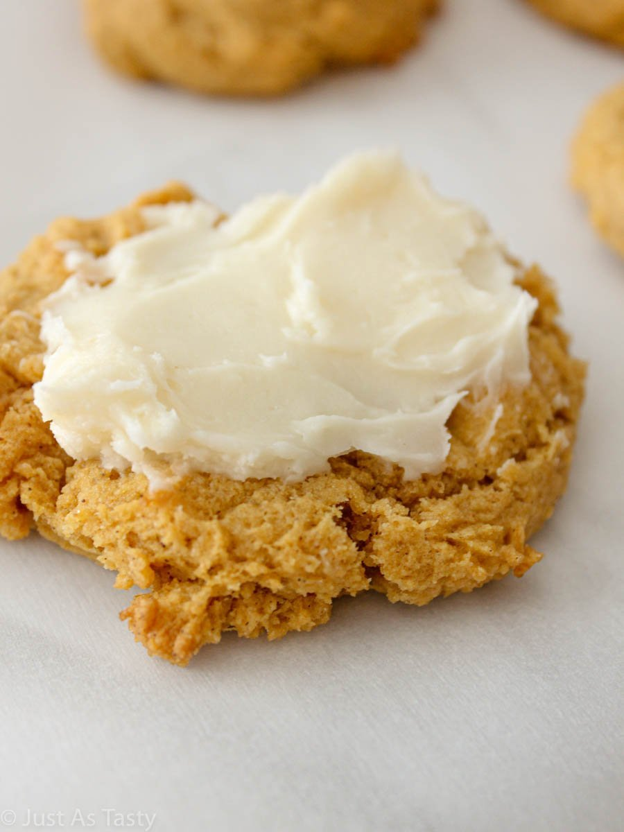 Close-up of soft pumpkin cookie with cream cheese frosting.