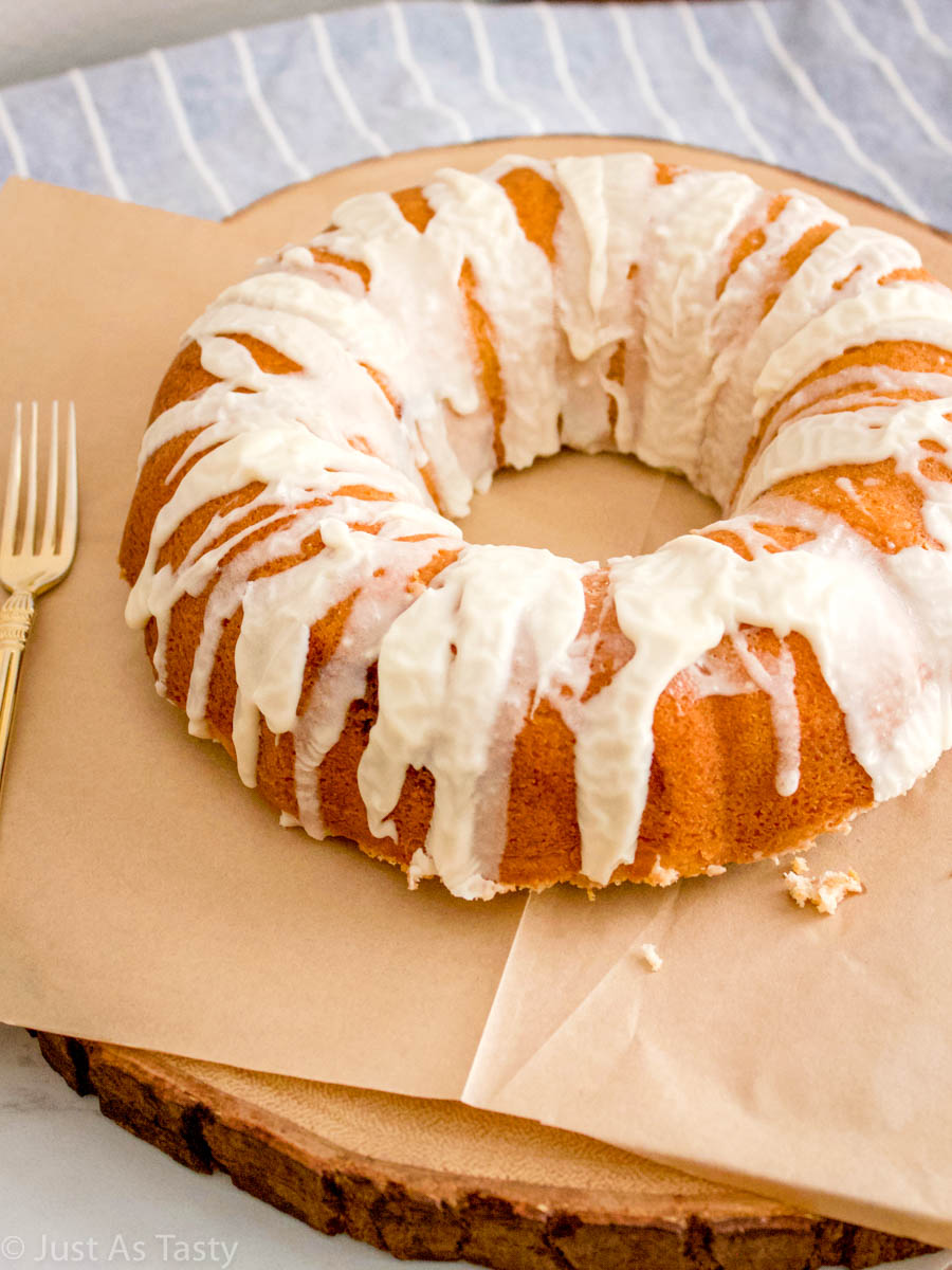 Gluten free cinnamon roll cake with a white glaze on parchment paper.
