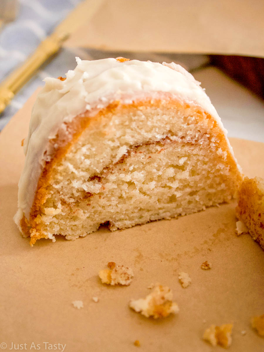 Slice of gluten free cinnamon roll cake on parchment paper.