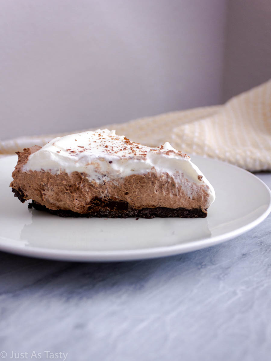 Slice of chocolate mousse pie on a white plate.