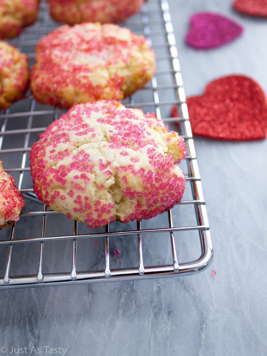 Close-up of a sugar cookie coated in pink sanding sugar.