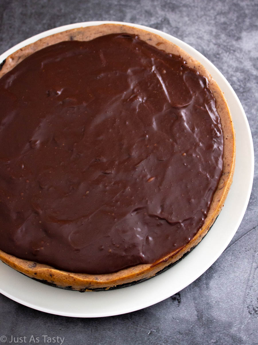 Gluten free chocolate cheesecake on a white plate.