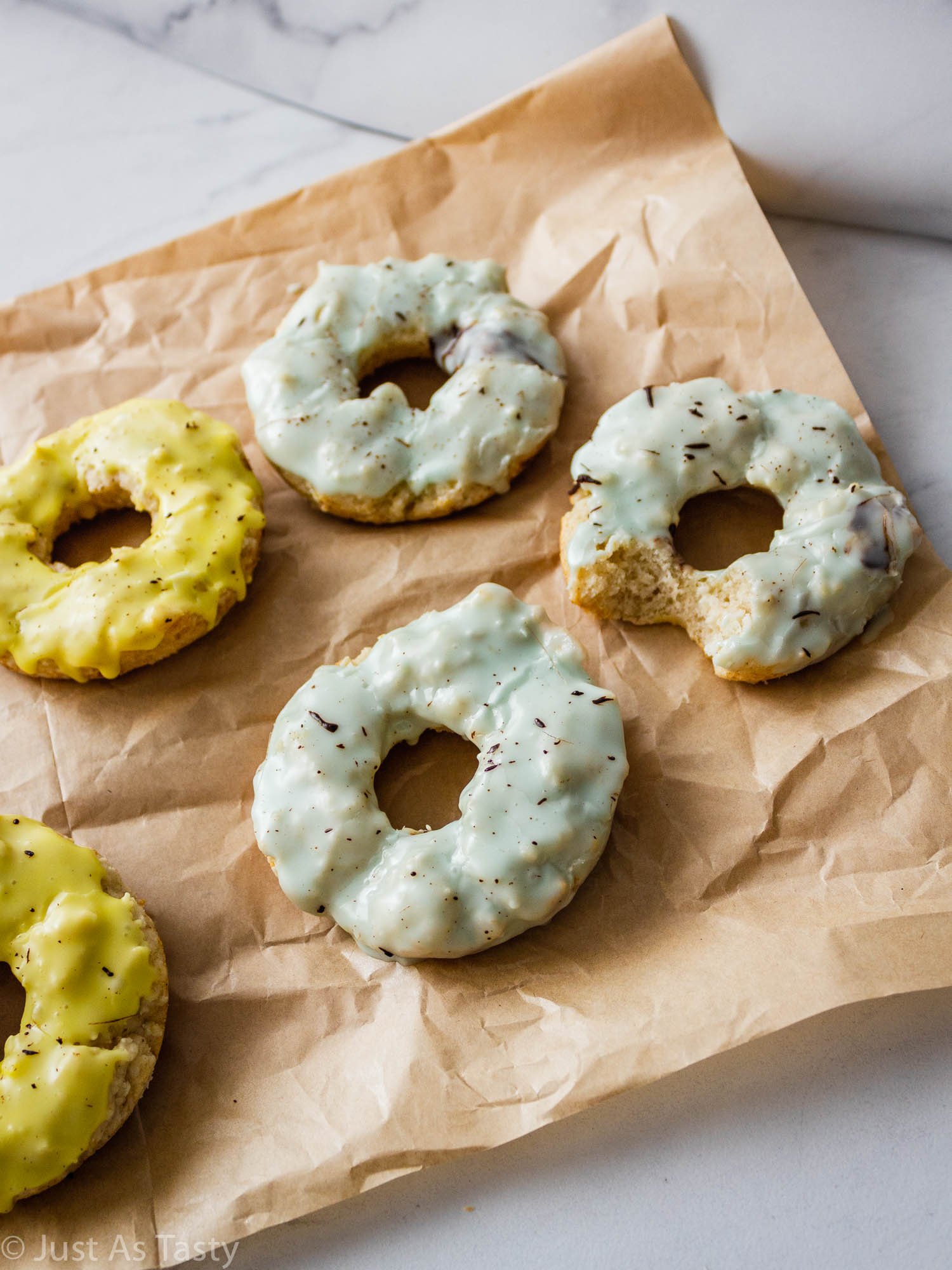 Baked banana donuts on parchment paper.