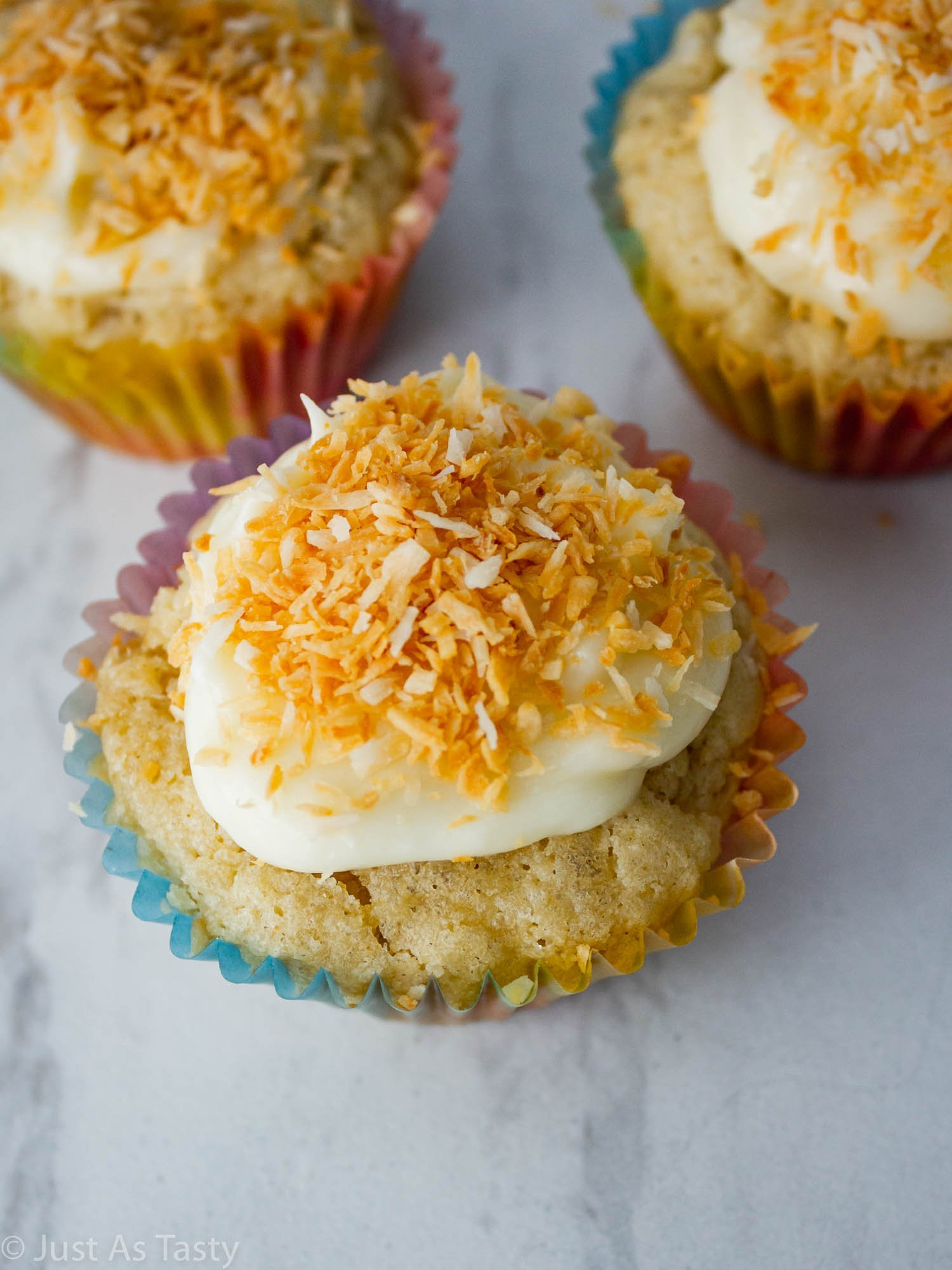 Close-up of a frosted coconut cupcake.