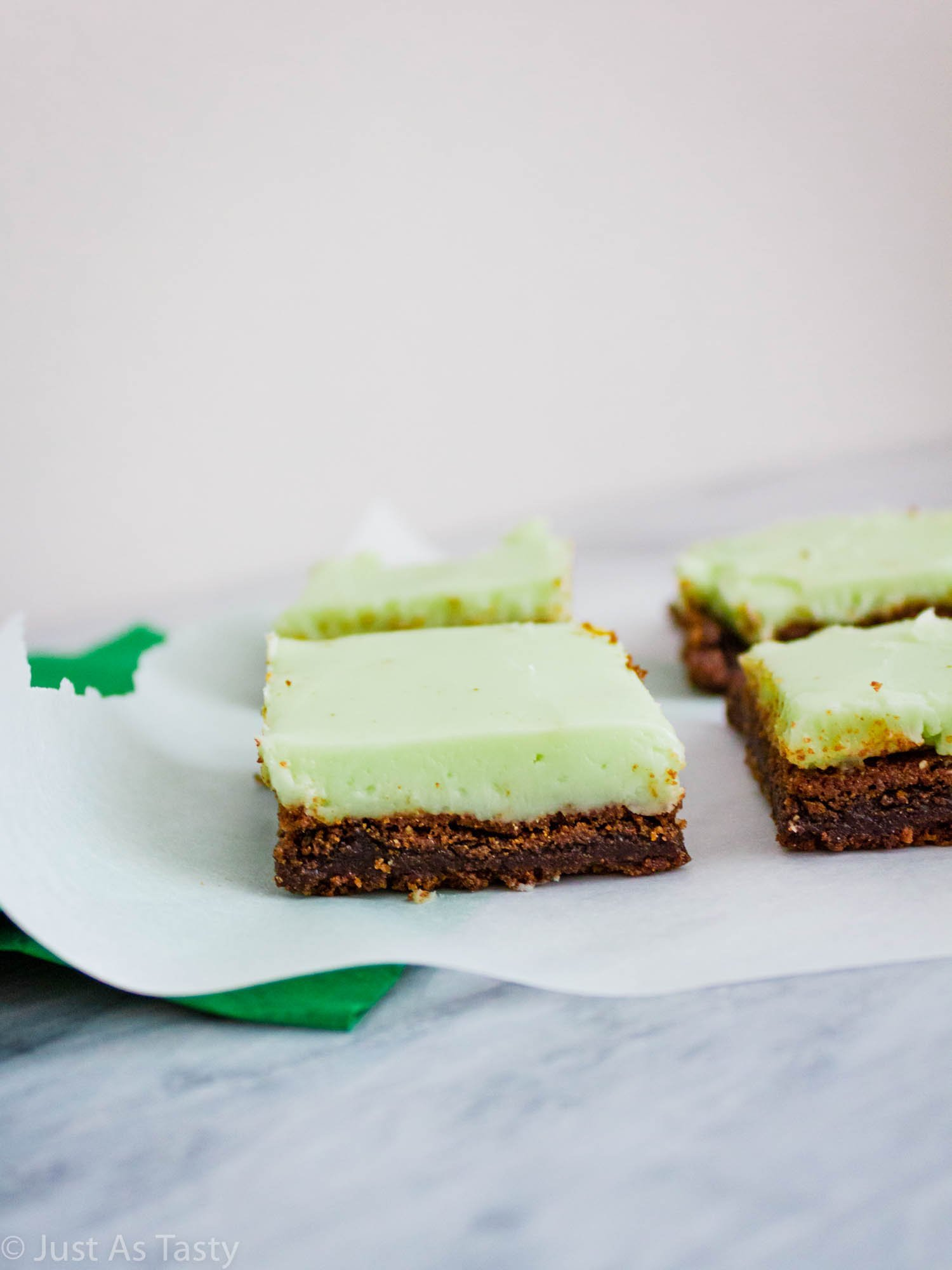 Grasshopper brownies on white parchment paper.