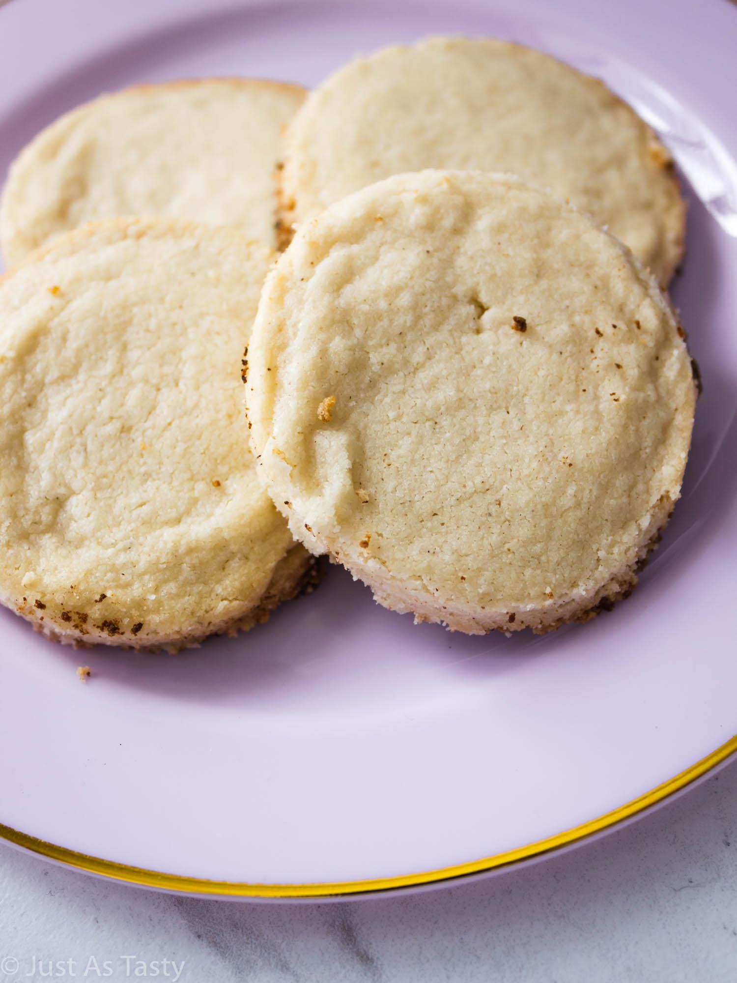 Lavender shortbread cookies on a light purple plate.