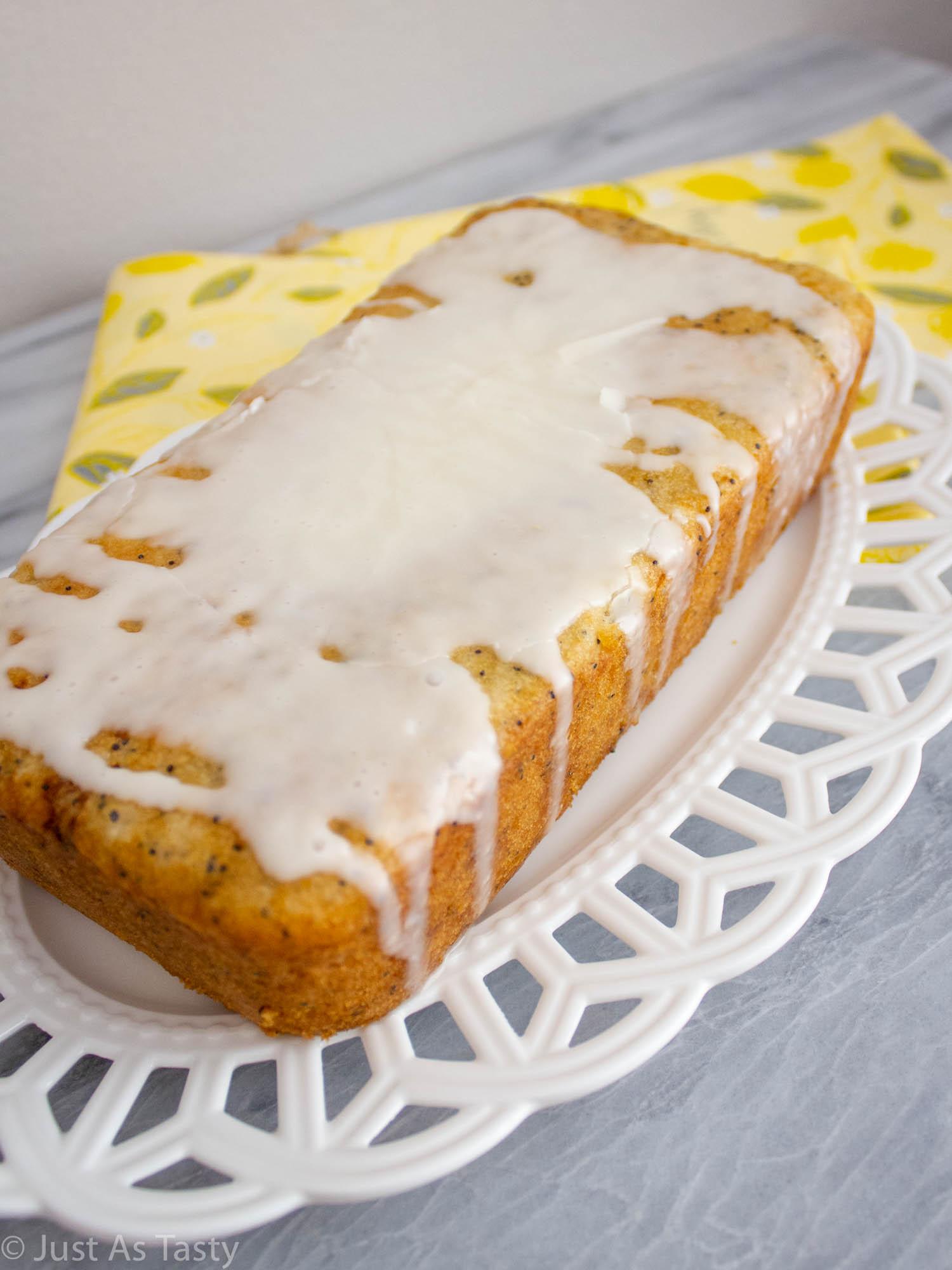 Gluten free lemon poppy seed loaf with a glaze on top.