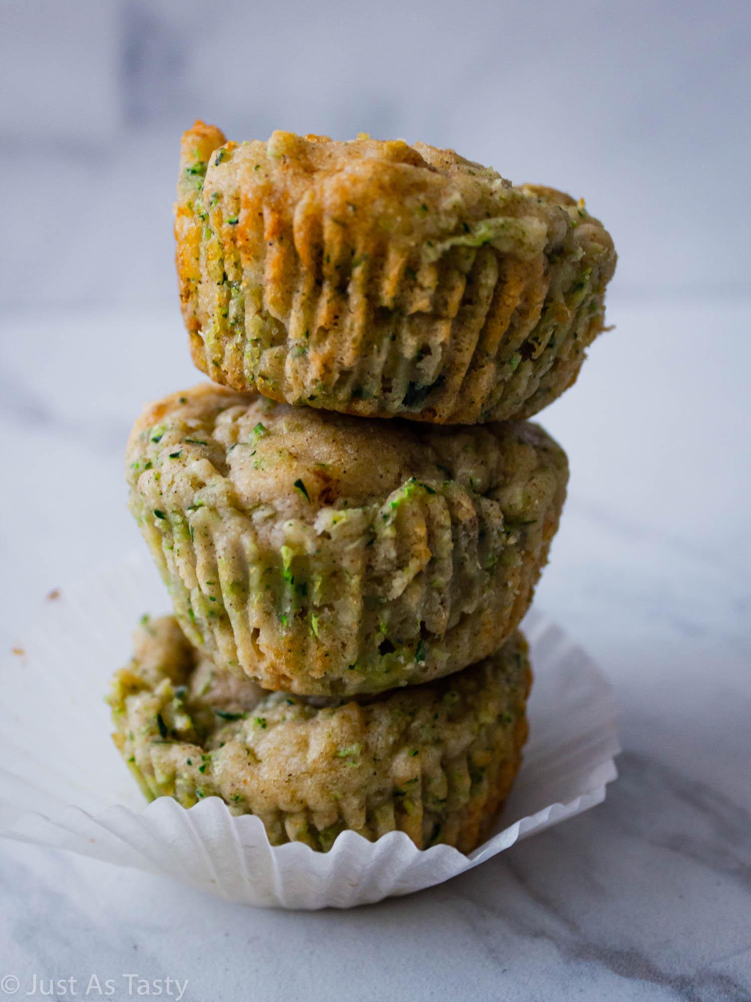 Stack of three gluten free zucchini muffins.