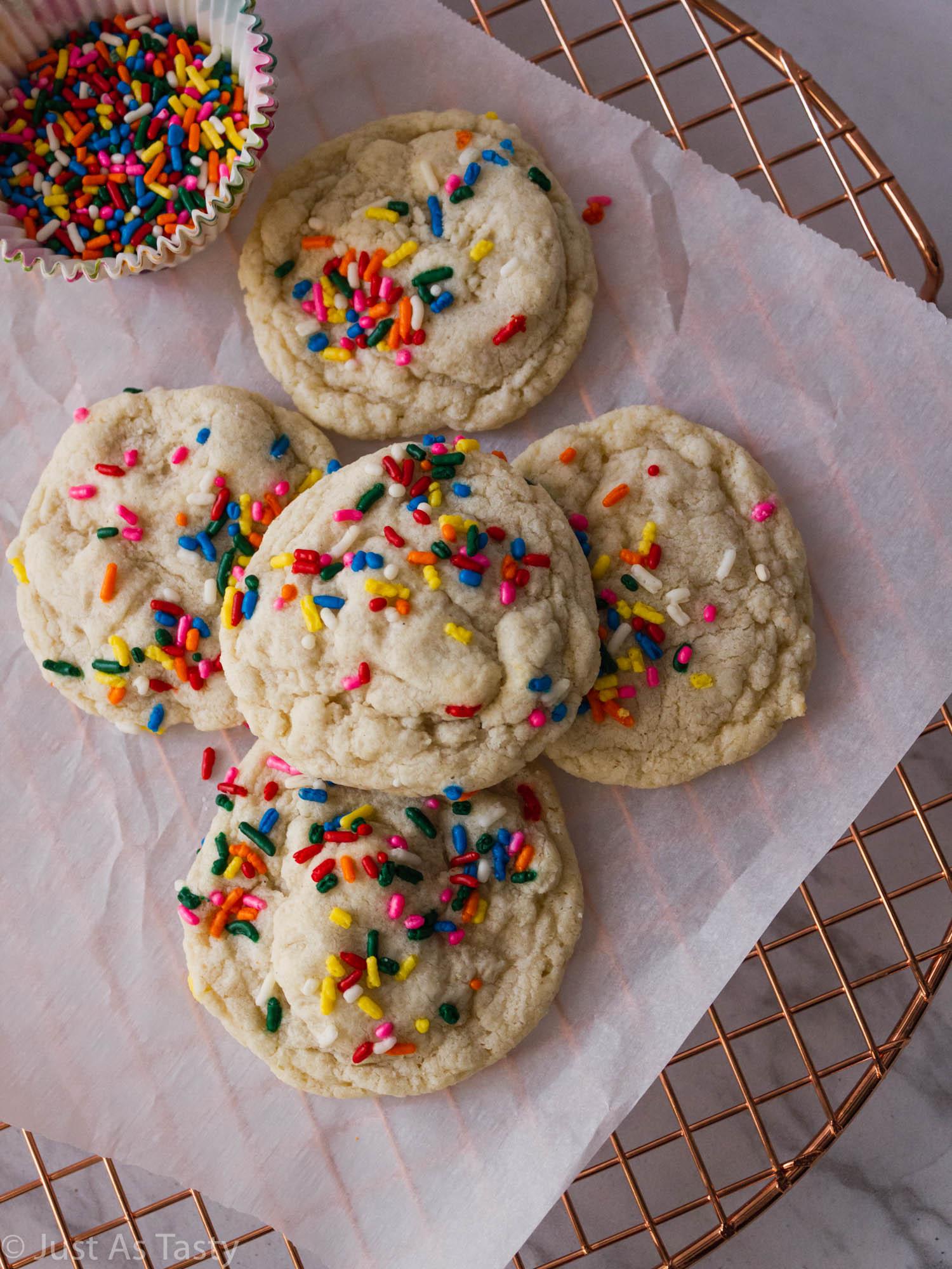 Sugar cookies topped with rainbow sprinkles.