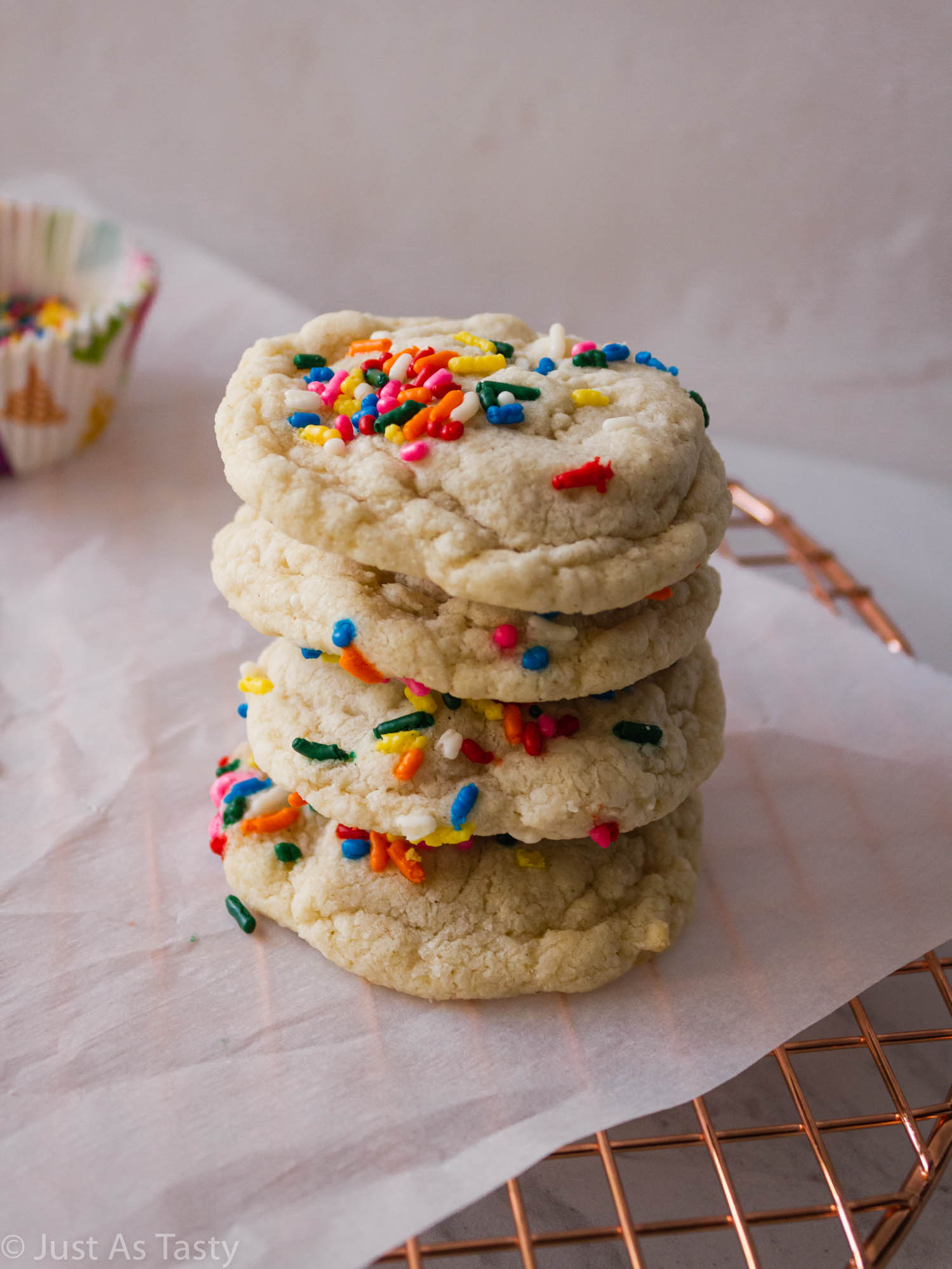 Stack of birthday cake cookies.