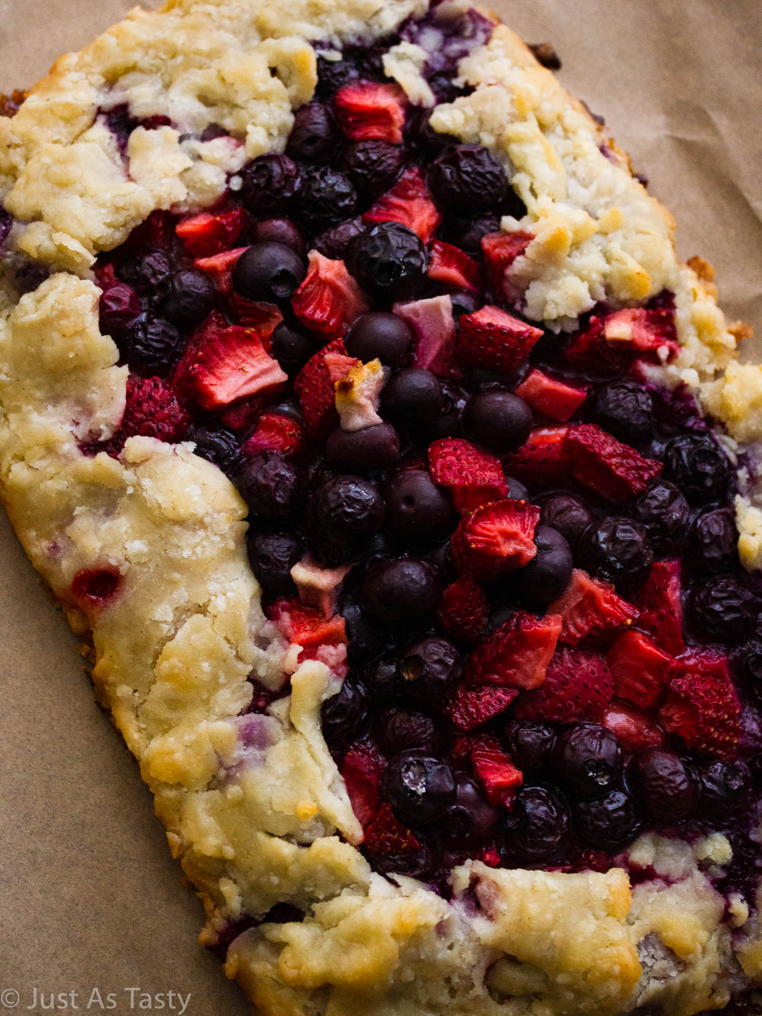Berry galette on parchment paper.
