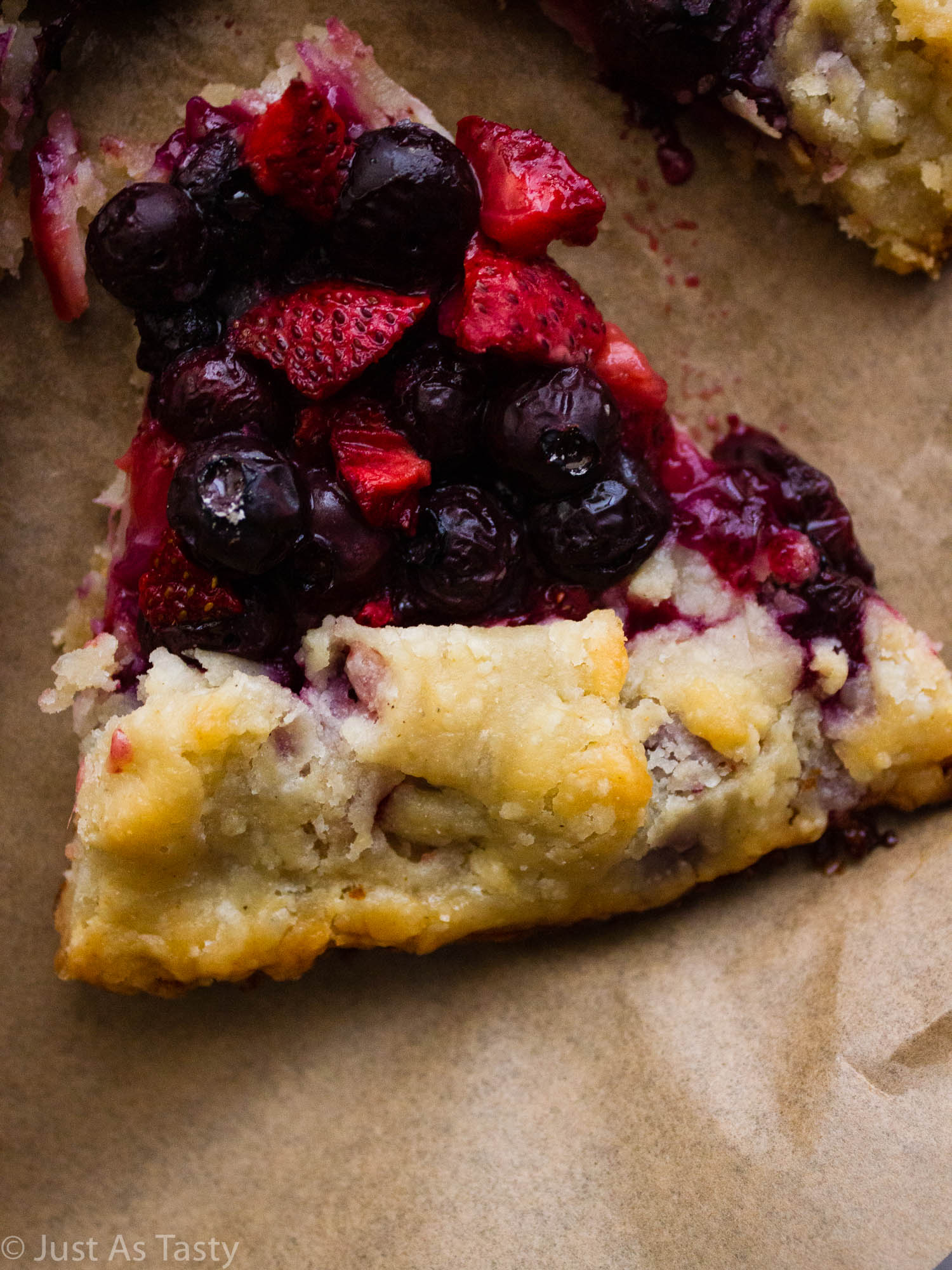 Close-up of a slice of galette filled with berries.