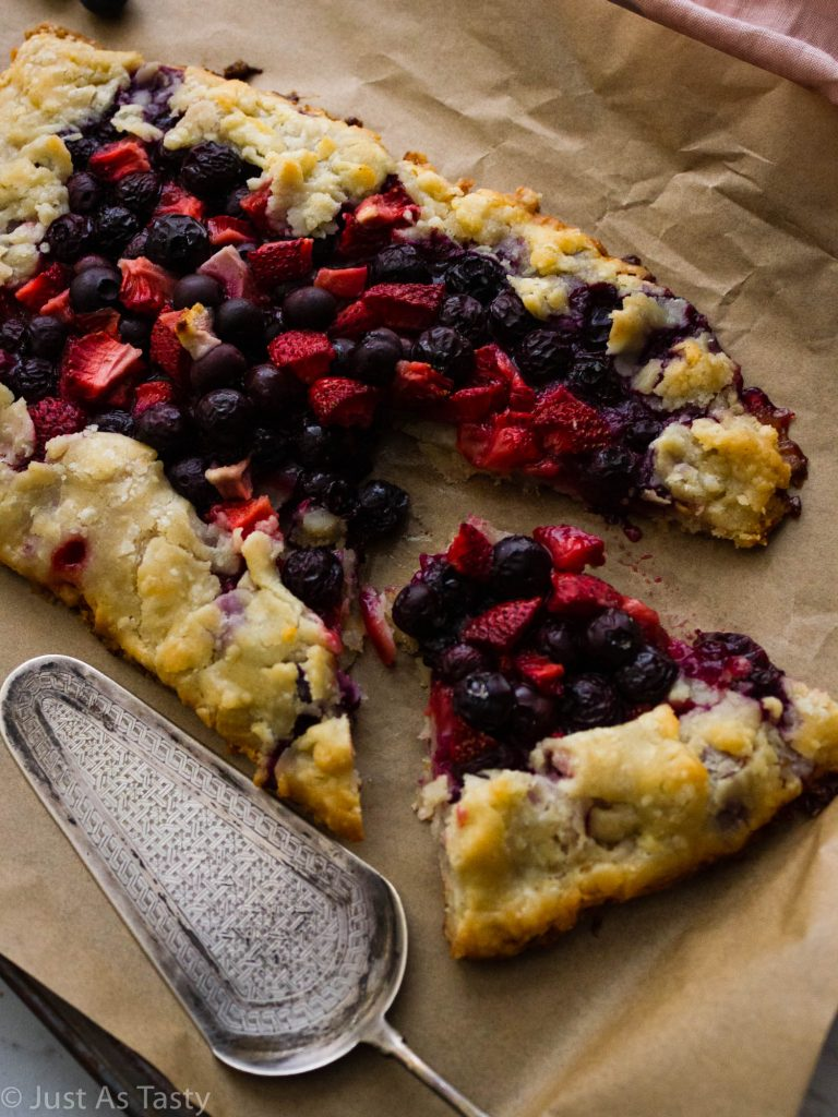Berry galette with one slice cut out.