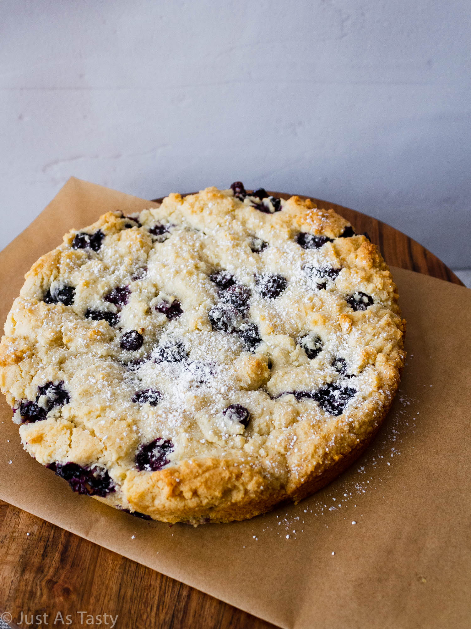 Gluten free blueberry cake topped with powdered sugar.