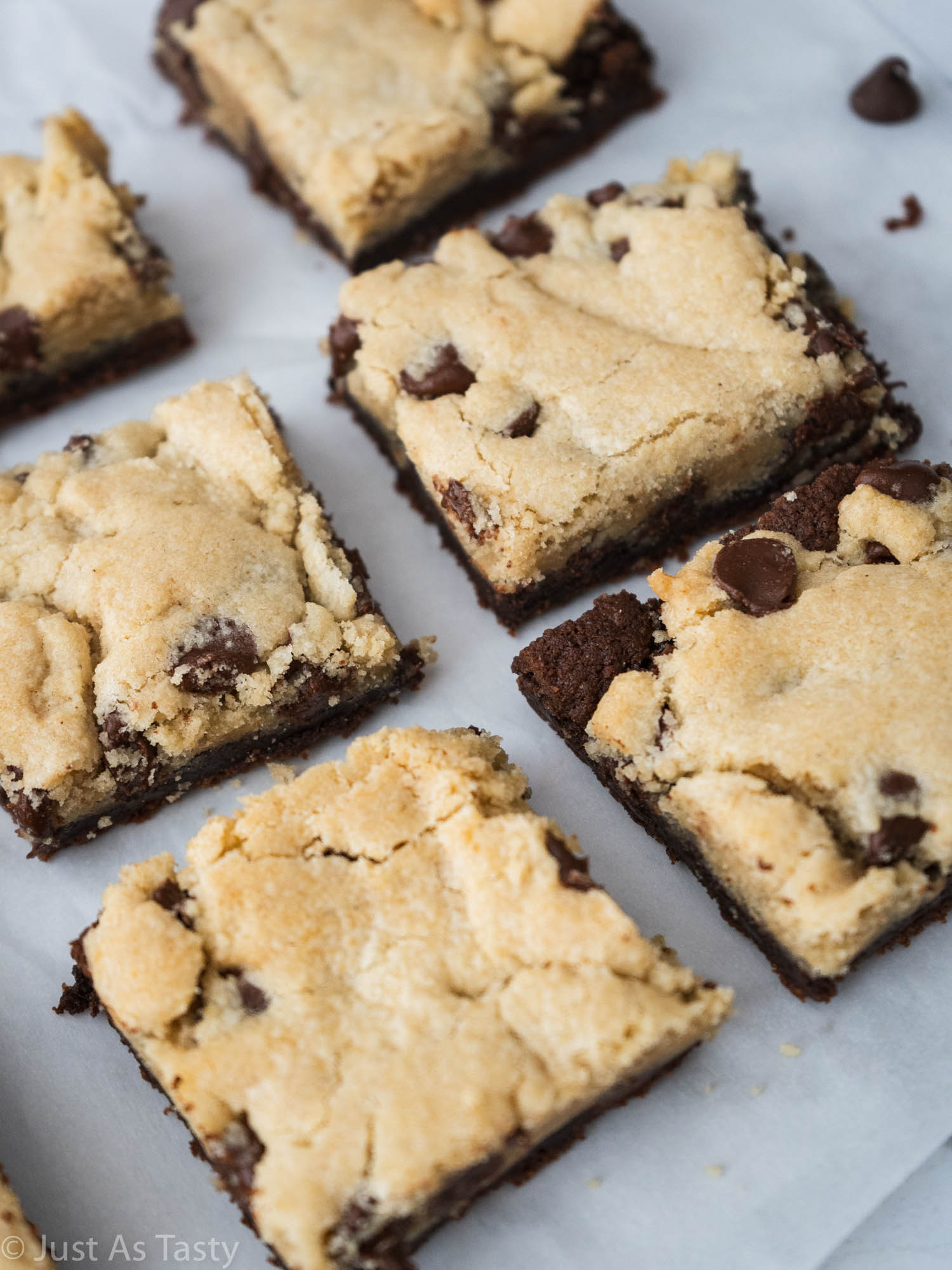 Brookie bars on white parchment paper.