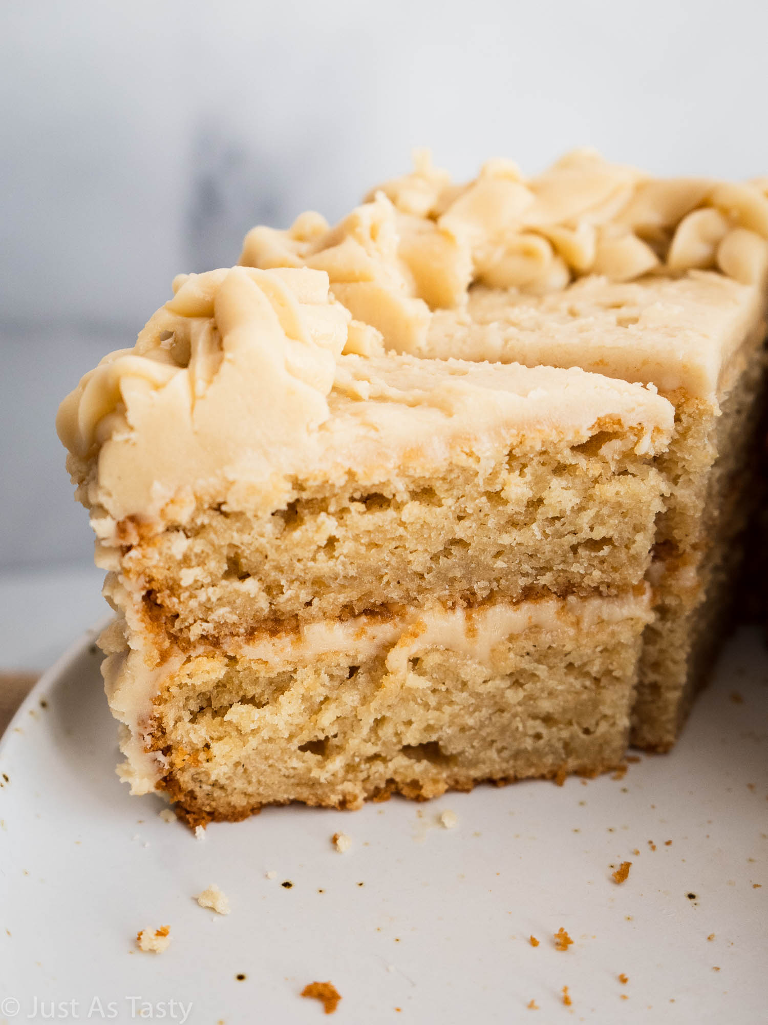 Close-up of a slice of two-layer butterscotch cake.