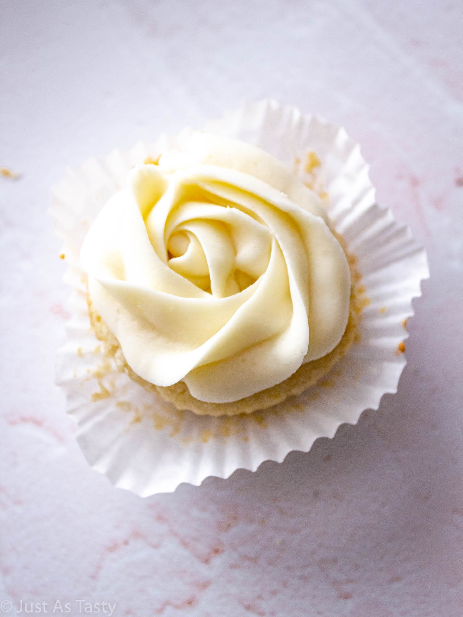 Close-up of a frosted vanilla cupcake.