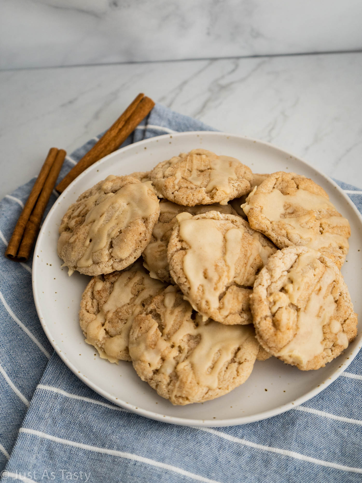 Maple snickerdoodles on a white plate.