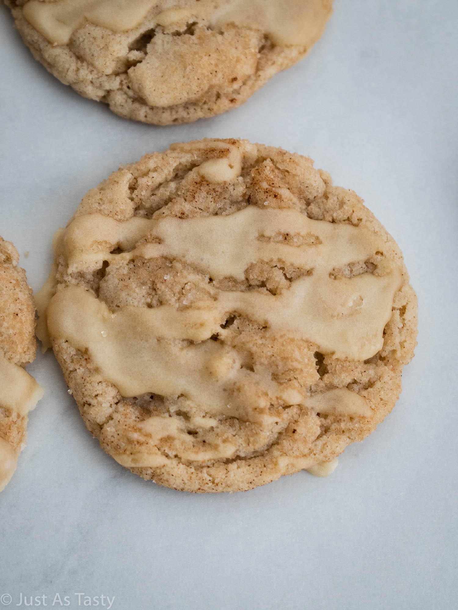 Close-up of a maple glazed snickerdoodle cookie.