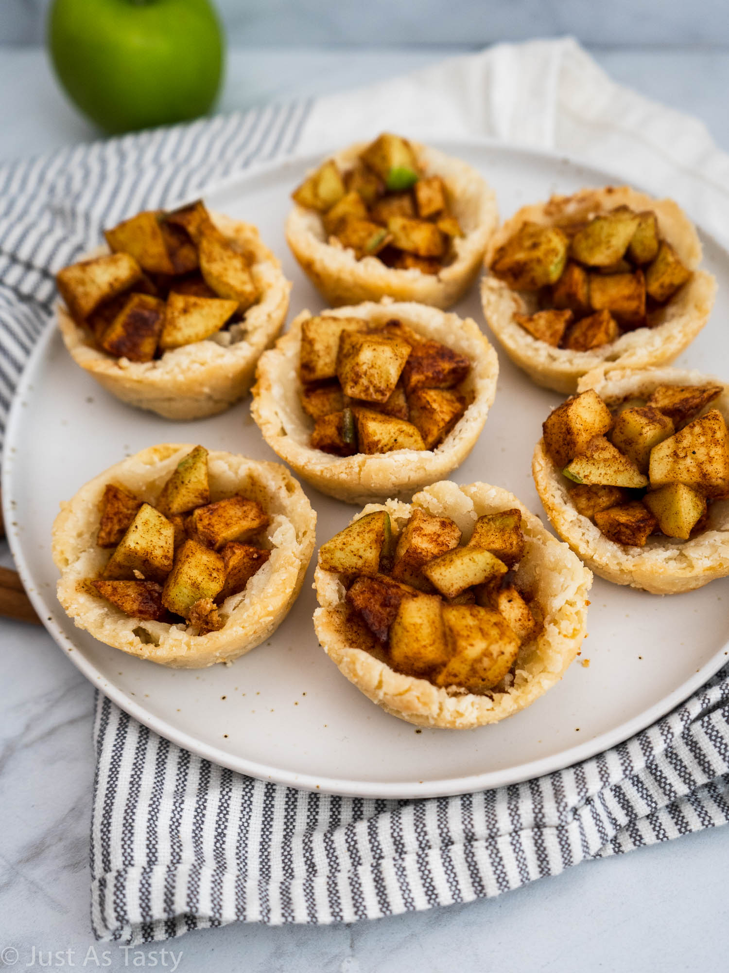 Mini pies on a white plate.